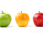 three different colored apples