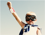 little boy dressed as a super hero