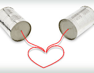 tin can telephone with string forming a heart