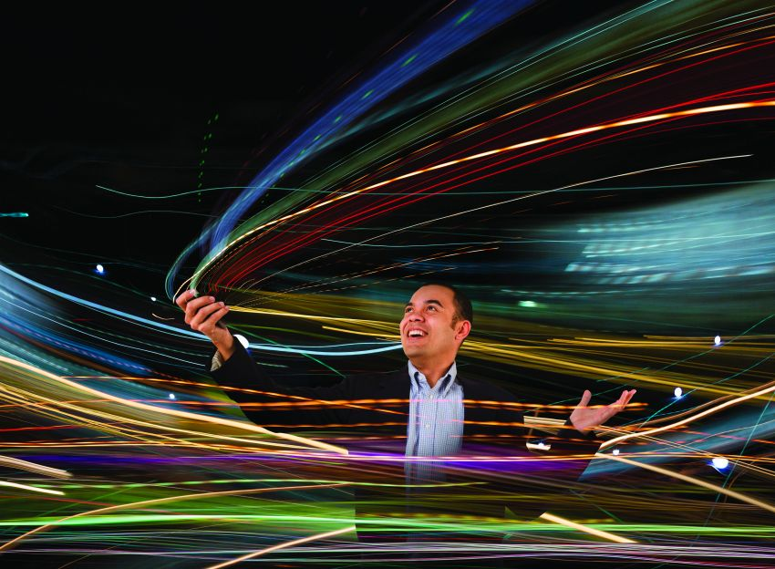 Man playing with multi-colored laser lights