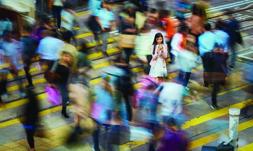 Girl standing in a crowd